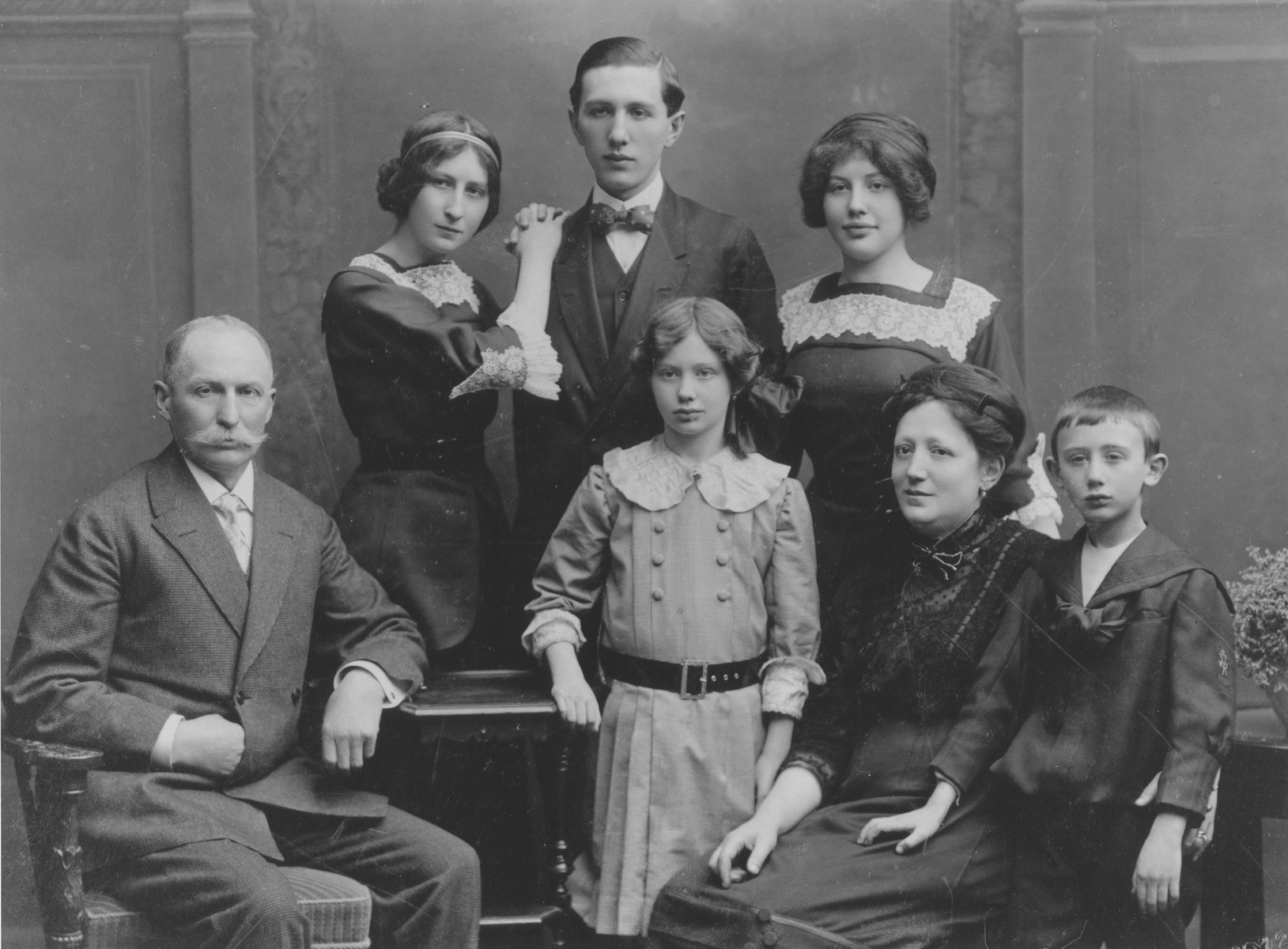 Portrait of the Brod family in Prague.  Seated from left to right are: Josef, Irma, Mathilda and Leo Brod.  Standing are Frieda, Karel and Anna.