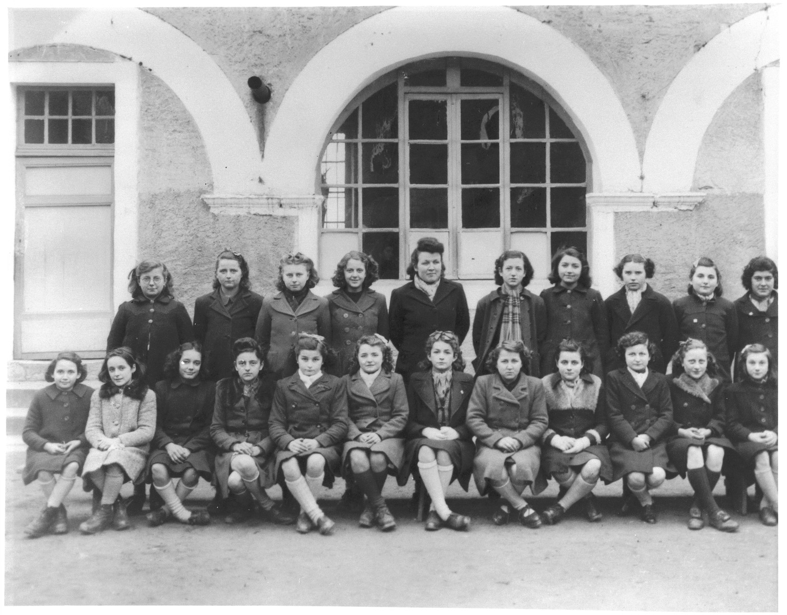 Group portrait of Denise Bystryn and her classmates in a convent school in Cahors where Denise was hidden in 1943.  Denise Bystryn, a hidden child, is seated in the first row on the far left.