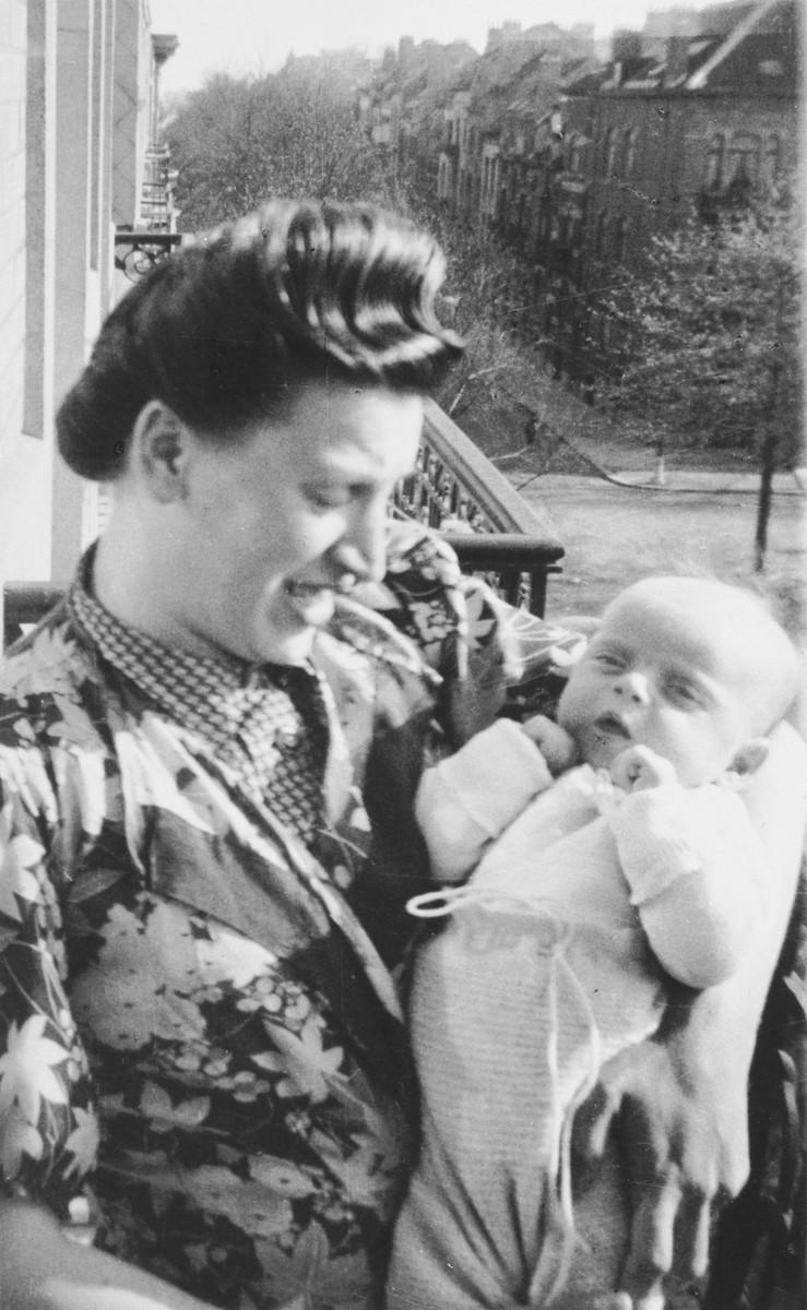 Frajdla Birnbaum holds her newborn daughter, Marguerite-Rose.