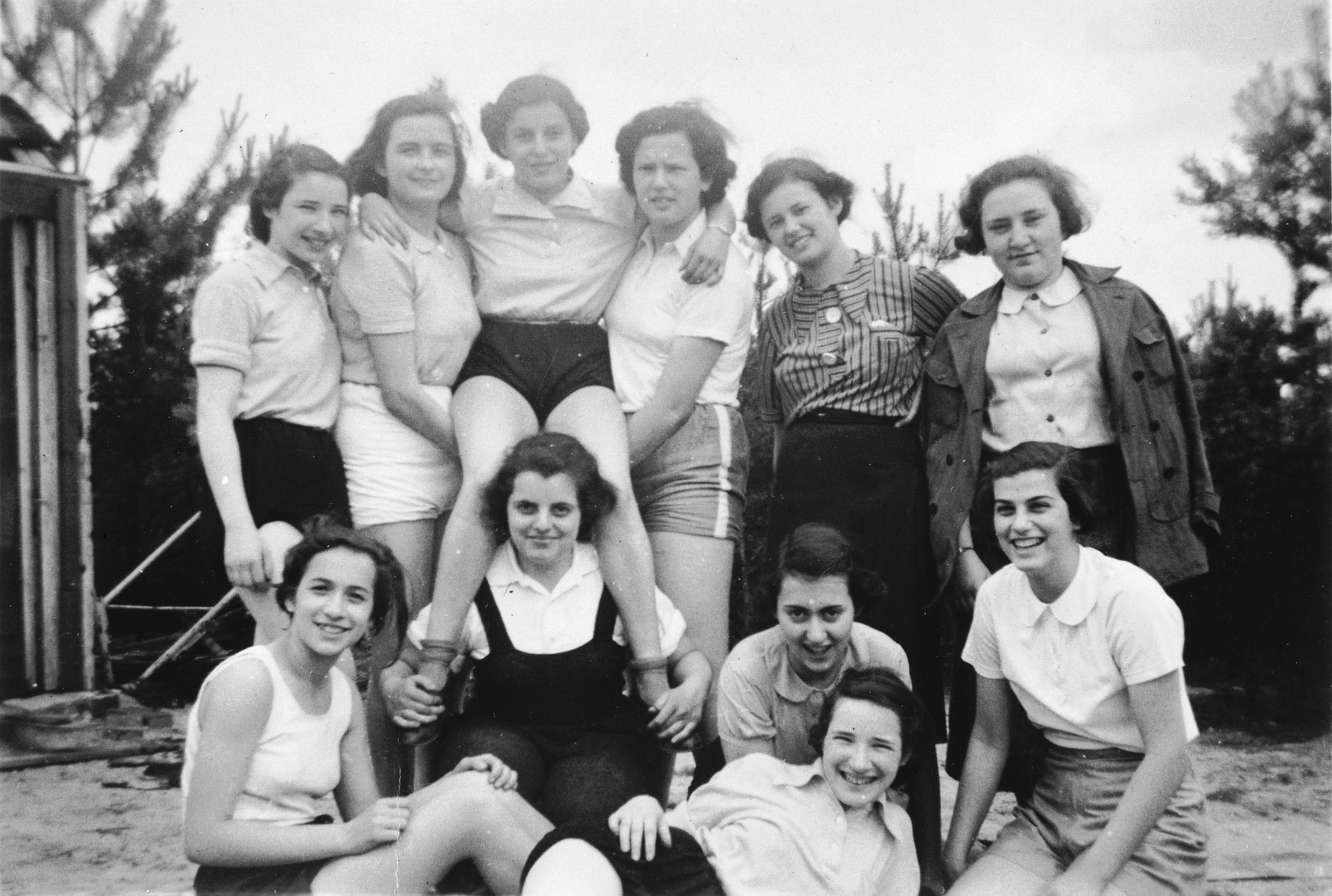 Group portrait of German-Jewish teenage girls on a Sunday outing to the country.  Among those pictured is Ruth Cohn.  She left on a Kindertransport to England two months later.