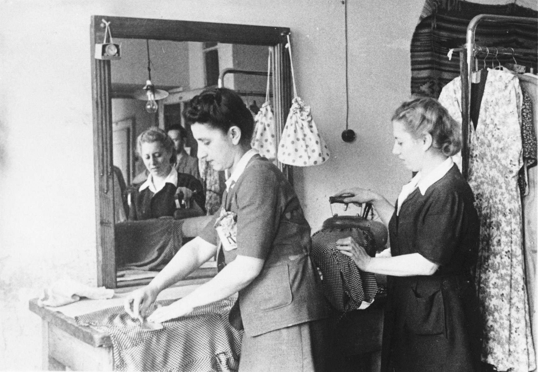 Female employees work in the Julius Madritsch Ladies' Custom Shop.  Pictured are Lusia Eichenholz (left) and Paula (right).