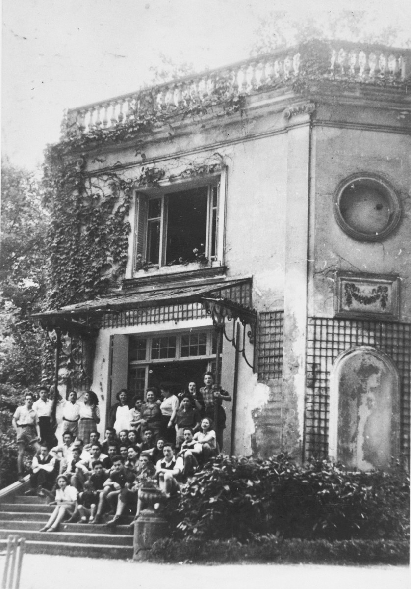 Students and staff pose on the front steps to the Malmaison children's home.