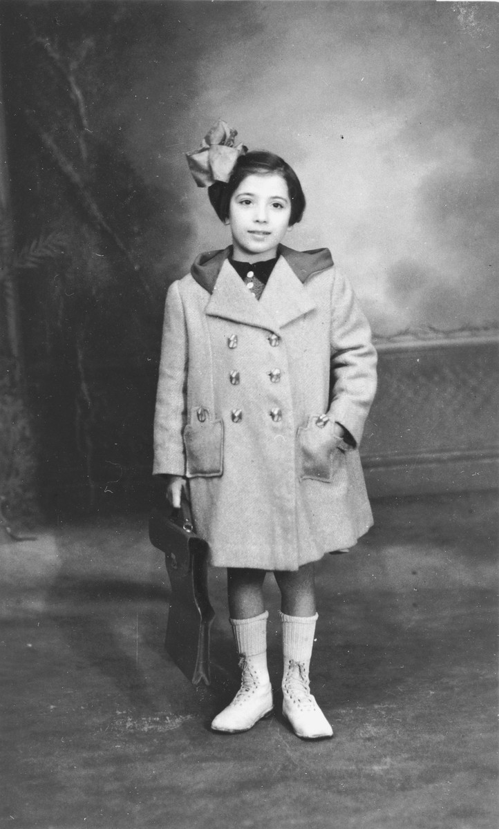 Portrait of Blanche Karakowski on the way to a violin lesson wearing a coat made by her mother taken before she went into hiding.