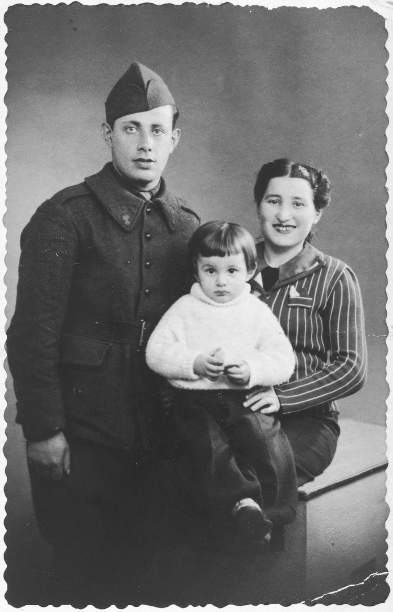 Rene Lichtman poses with his mother and father who is wearing his French army uniform.
