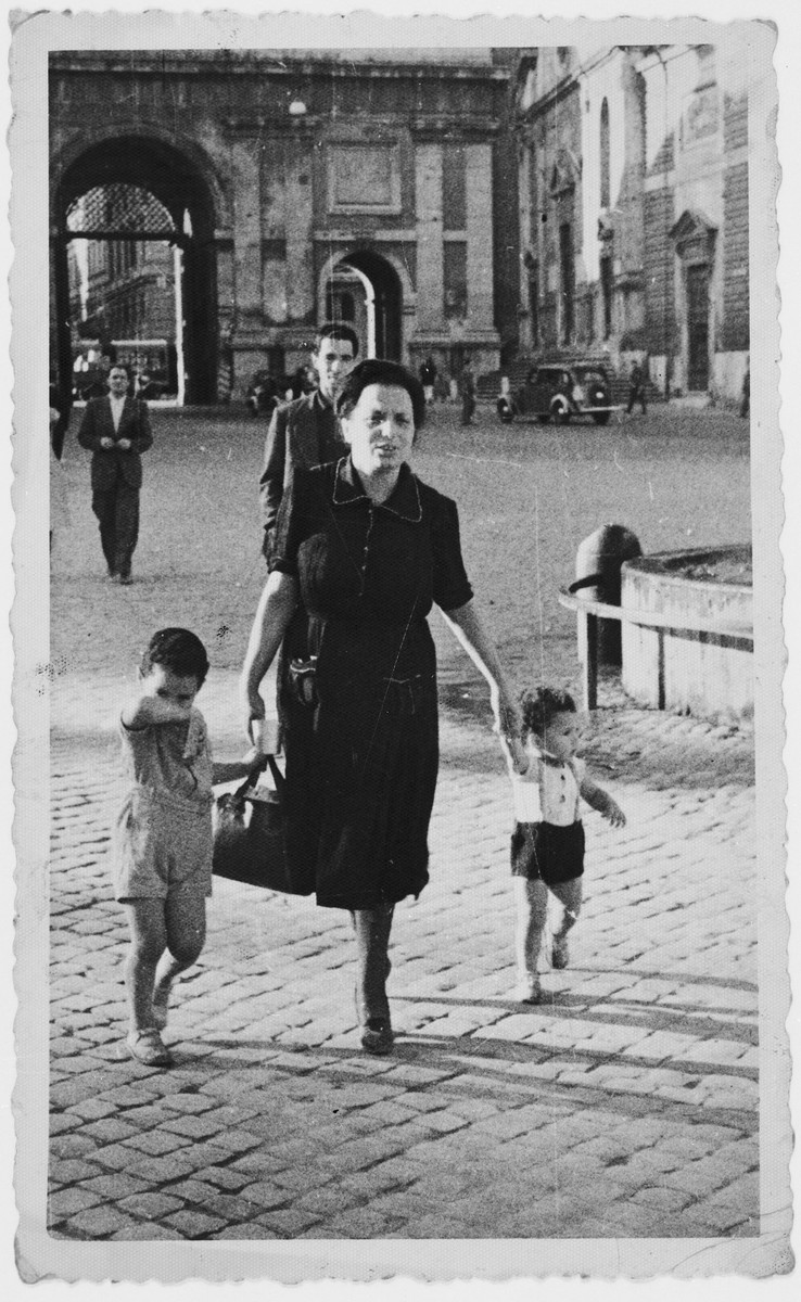 Lina Tagliacozzo walks down a street in Rome with her two young children David and Nando.