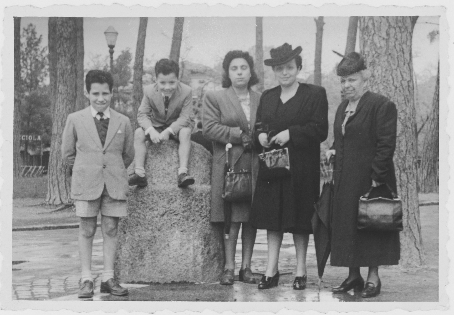 Members of the Tagliacozzo family pose together after the war.  From left to right are Nando,  David, and Lina Tagliacozzo, Titti Zarfatti, and Lina's mother, Judita Zarfatti.