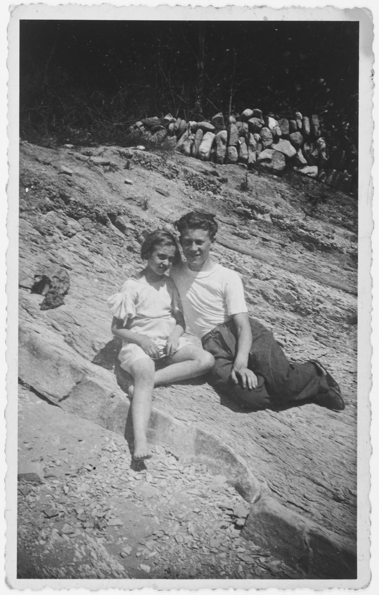 Franco and his younger sister Elda sit on a rocky mountain in Emilia-Romagna where they are hiding.