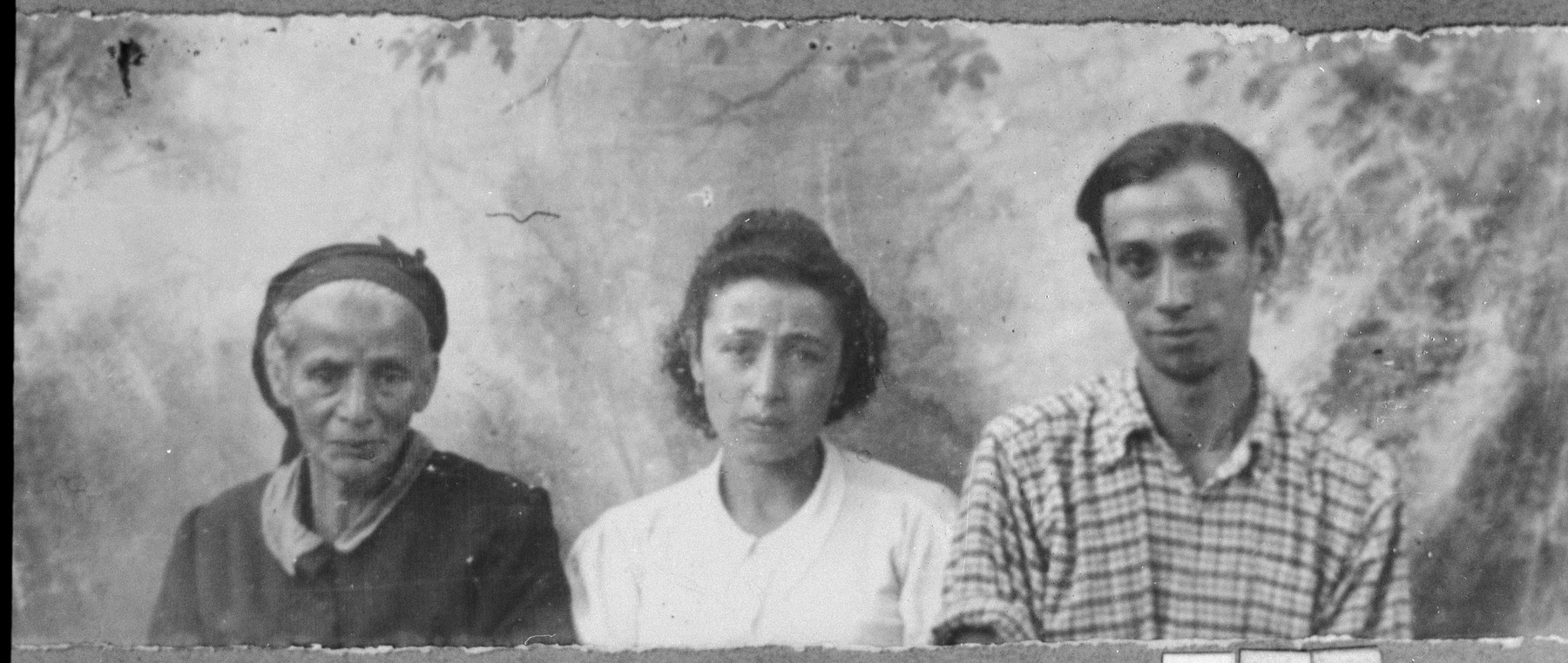 Portrait of Miriam Talvi [wife of Isak Talvi], Shabetai Talvi, son of Isak, and Rosa Talvi, daughter of Isak.  Shabetai was a laborer.  The lived at Drinska 99 in Bitola.