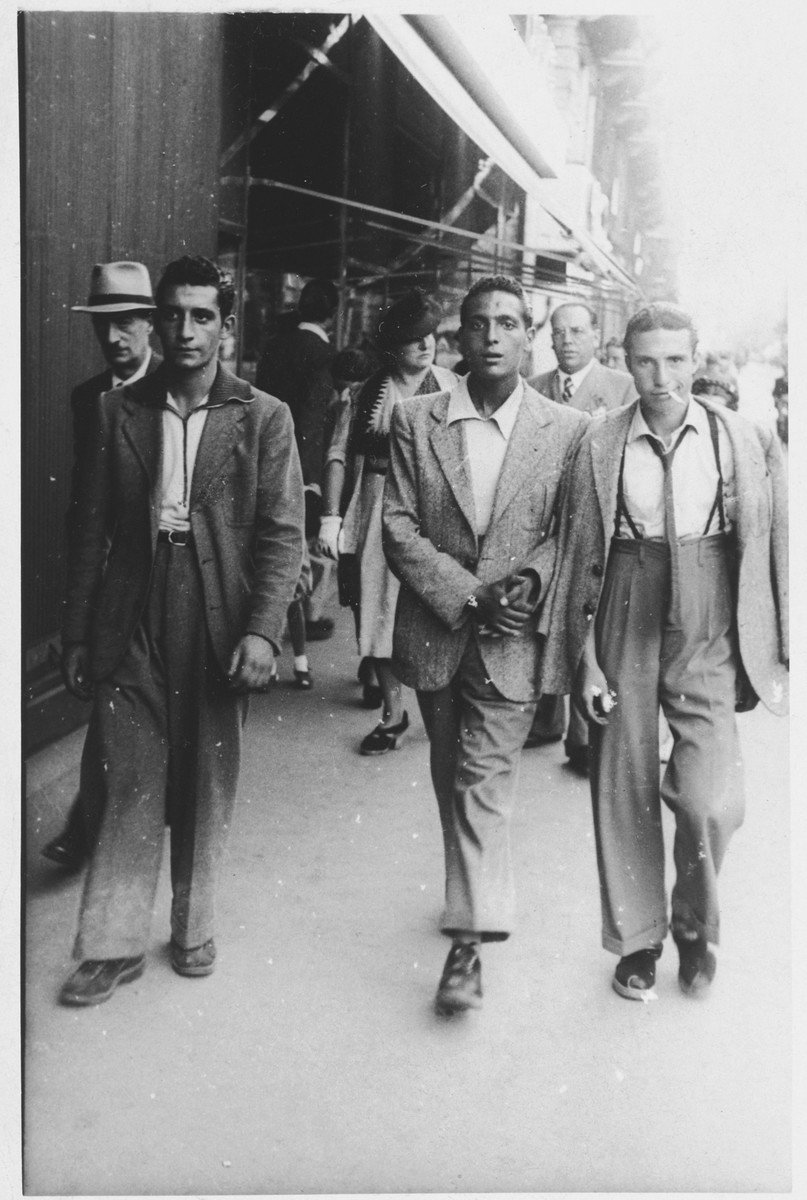 Three young men walk down a street in Rome.  Pictured are Di Tivoli, Giuseppe Di Porto and Isacco Bonnino.