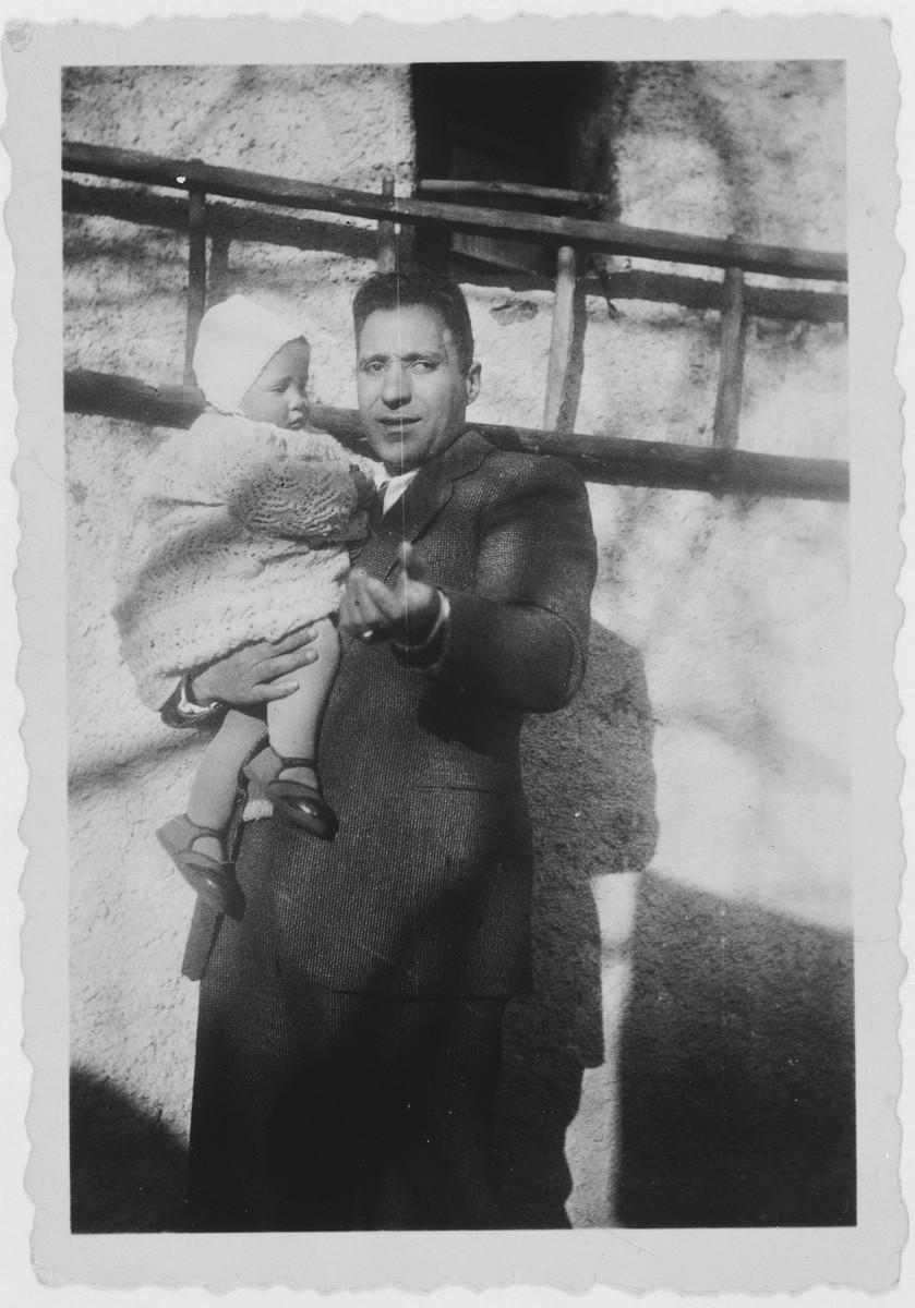 Arnaldo Tagliacozzo holds his baby son David.