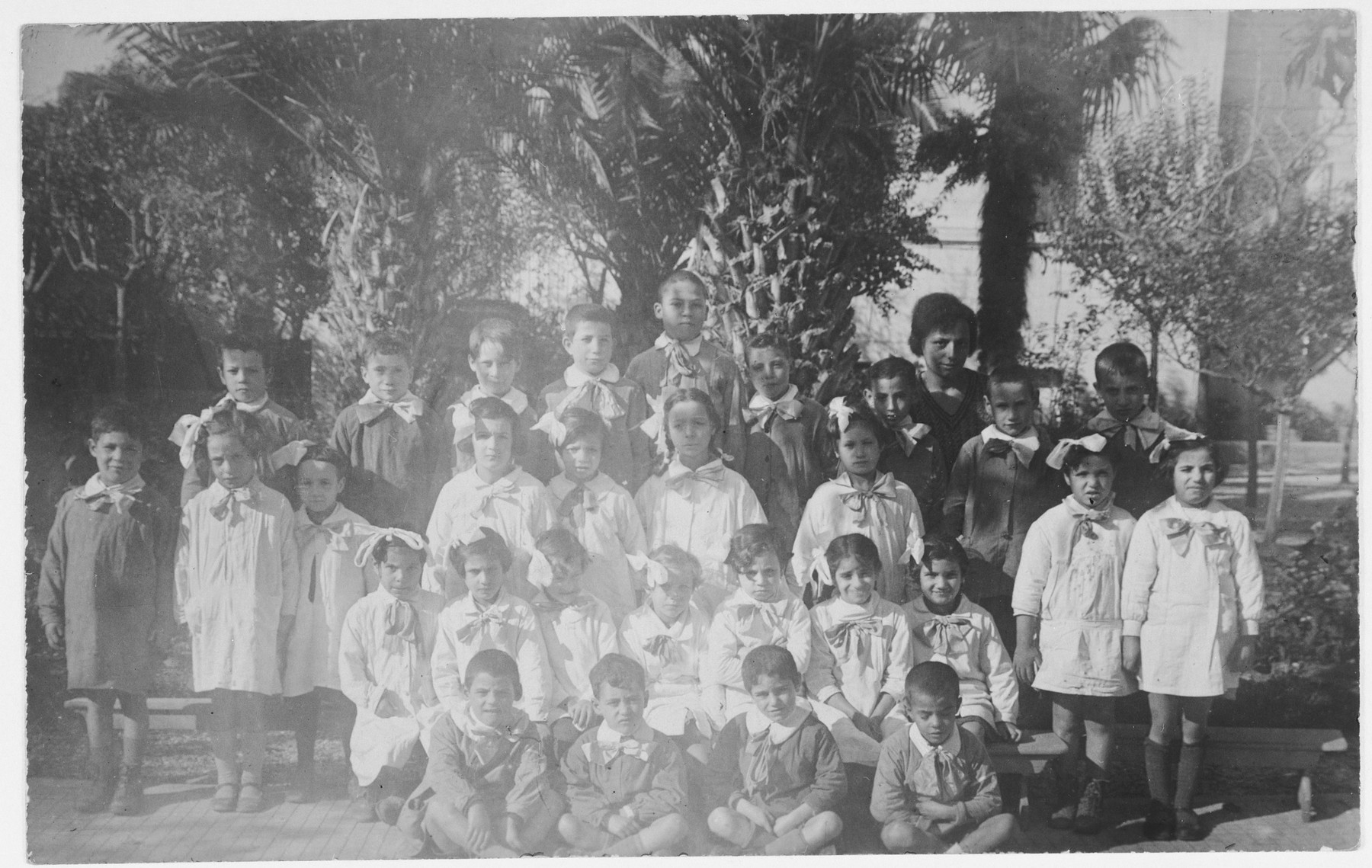 Lina Zarfatti poses with the children in her class at the Jewish L'Ecole Polacco in Rome.