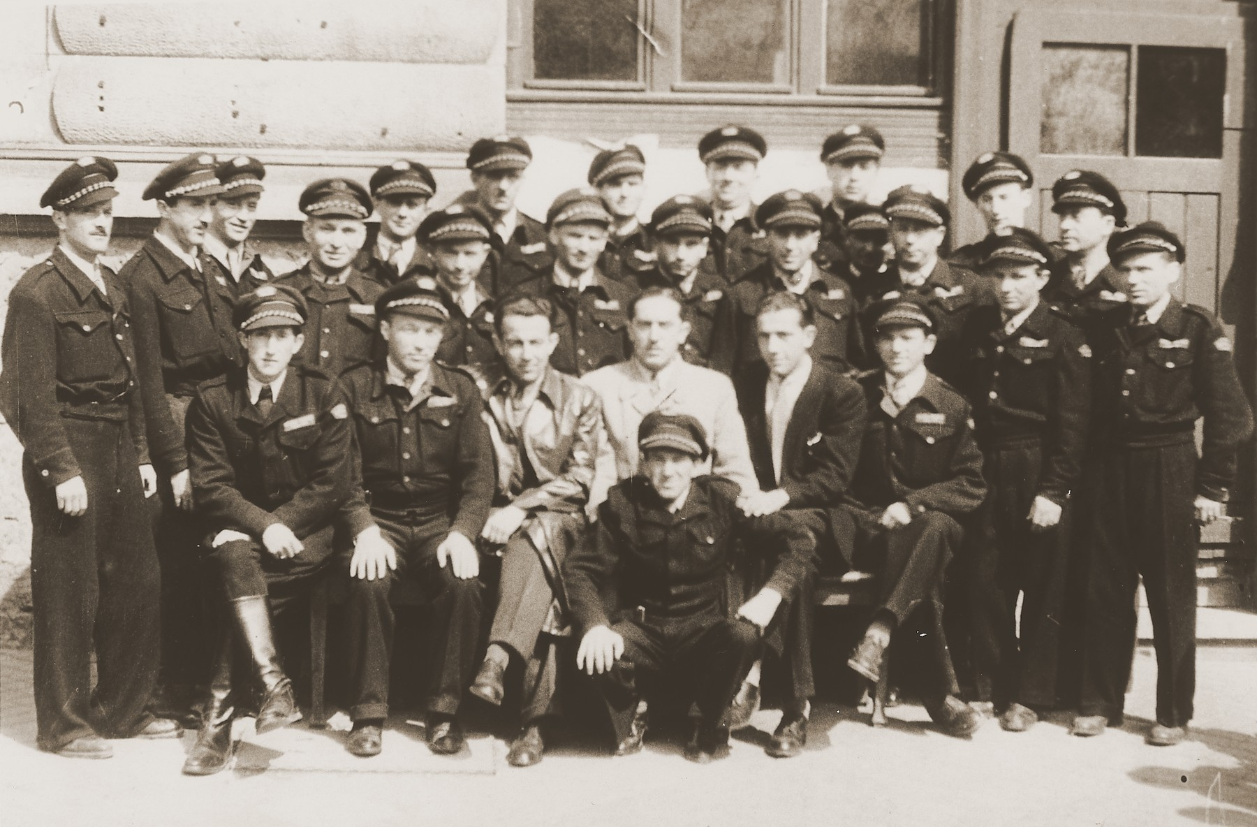 "Group portrait of members of the Jewish police force at the Stuttgart DP camp.  One image from the Stuttgart Jewish DP camp album entitled, ""Jidiszer D.P. Center UNRRA--P.C.IRO in Stuttgart,"" compiled and photographed by Alexander Fiedel and dedicated to Moses Kornberg, head of the commissary."