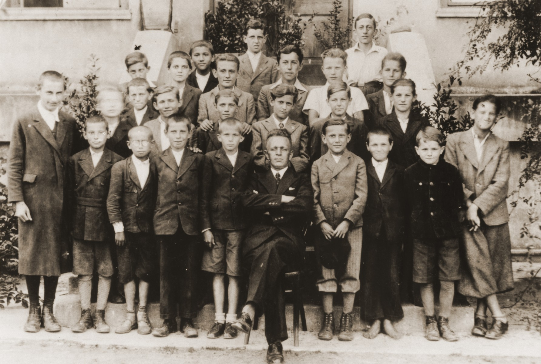 Group portrait of students and teachers at a school in Oswiecim, Poland.  Among those pictured is Szmuel Aron Silbiger.