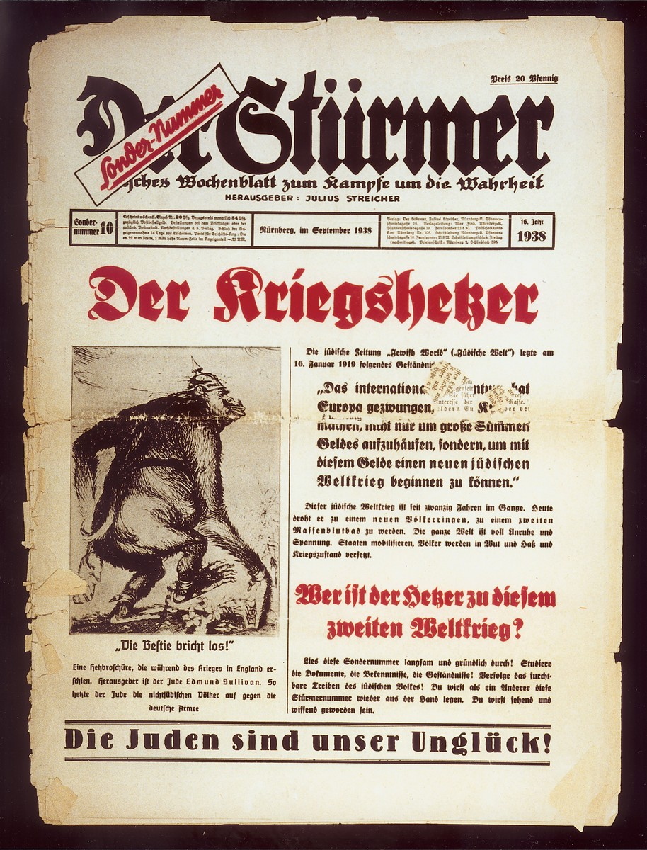 "Front page of the Nazi publication, Der Stuermer, with an anti-Semitic caricature depicting the Jew as the instigator of war.    The caption reads, ""Die Bestie bricht los!/ Eine hettzbroschuere, die waehrend des krieges in England erschien./ Herausgeber ist der Jude Edmund Sullivan.  So hetzte der Jude die nichtjuedischen Voelker auf gegen die deutsche Armee. "" [The beast is on the loose!/A smearing brochure which appeared during the war with England./Published by the Jew Edmund Sullivan.  This is how the Jew incites the non-Jewish peoples against the German Army.]  The headline reads, ""Der Kriegshetzer"" [The War Instigator].  The lead article begins, ""The Jewish newspaper, ""Jewish World,"" published this admission on January 16, 1919:  'International Jewry has convinced Europe to wage this war, not only to accumulate a huge sum of money, but also to use this money to start a new Jewish world war.'"