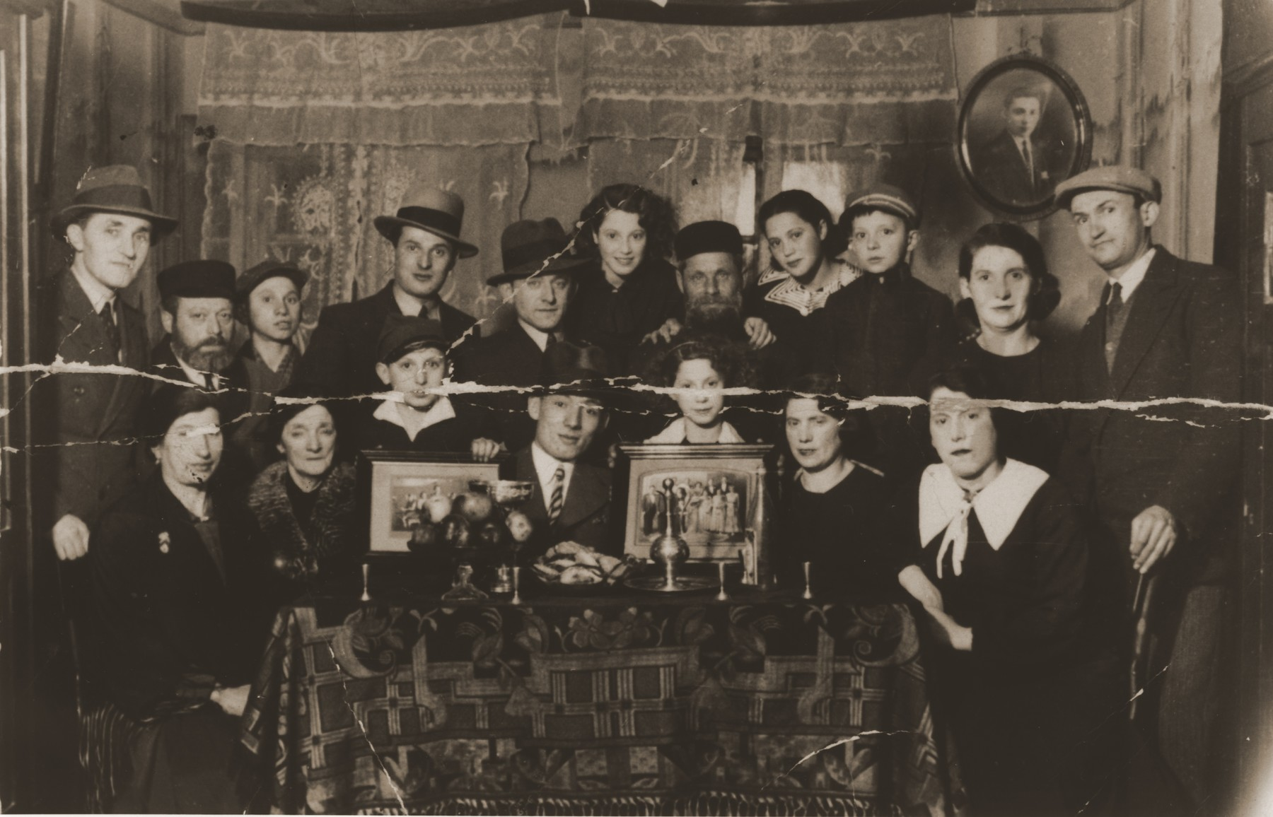 Members of the extended Berland family gathered around the table in their home in Chelm.    Among those pictured are Hanna Rachel Berland; oldest son Jankiel Berland and his wife Hanna; daughter Ethel and her husband Israel Lis and their three daughters Tobcia, Judith and Esther; daughter Sara and her husband Szymon Hilf, their son Heniek; daughter Chavele and her husband Avram Globen and son Yossele; and the four sons of the daughter Syma Berland Grinwald.