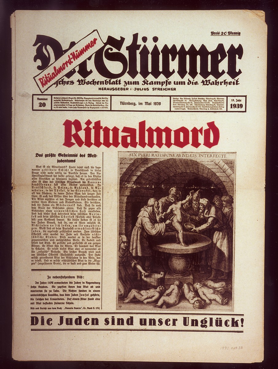 "Front page of the Nazi publication, Der Stuermer, with a reprint of a medieval depiction of a ritual murder.   The headline reads, ""Ritual Murder/The biggest secret of world Jewry.""  The caption reads, ""In 1476 the Jews of Regensburg murdered six boys.  They extracted their blood and put them to death as martyrs.  The judges found the bodies of the deceased in a subterranean space, which belonged to the Jew Josfal.  On an altar there stood a stone plate flecked with blood."""