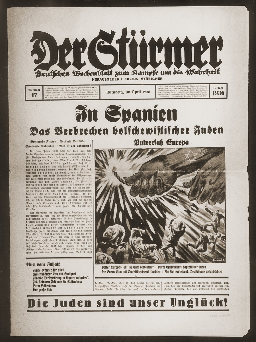 "Front page of the Nazi publication, Der Stuermer, with an anti-Semitic caricature depicting the Jew as the instigator of European conflict.  The caption under the caricature reads, ""People of Europe should you bleed for the sake of the Jews?""  The headline reads, ""In Spain/The Crime of Bolshevik Jews/Europe as a Powderkeg.""  The sub-heading reads, ""Burning churches/persecuted clergy/murdered non-Jews/Who is guilty?"""