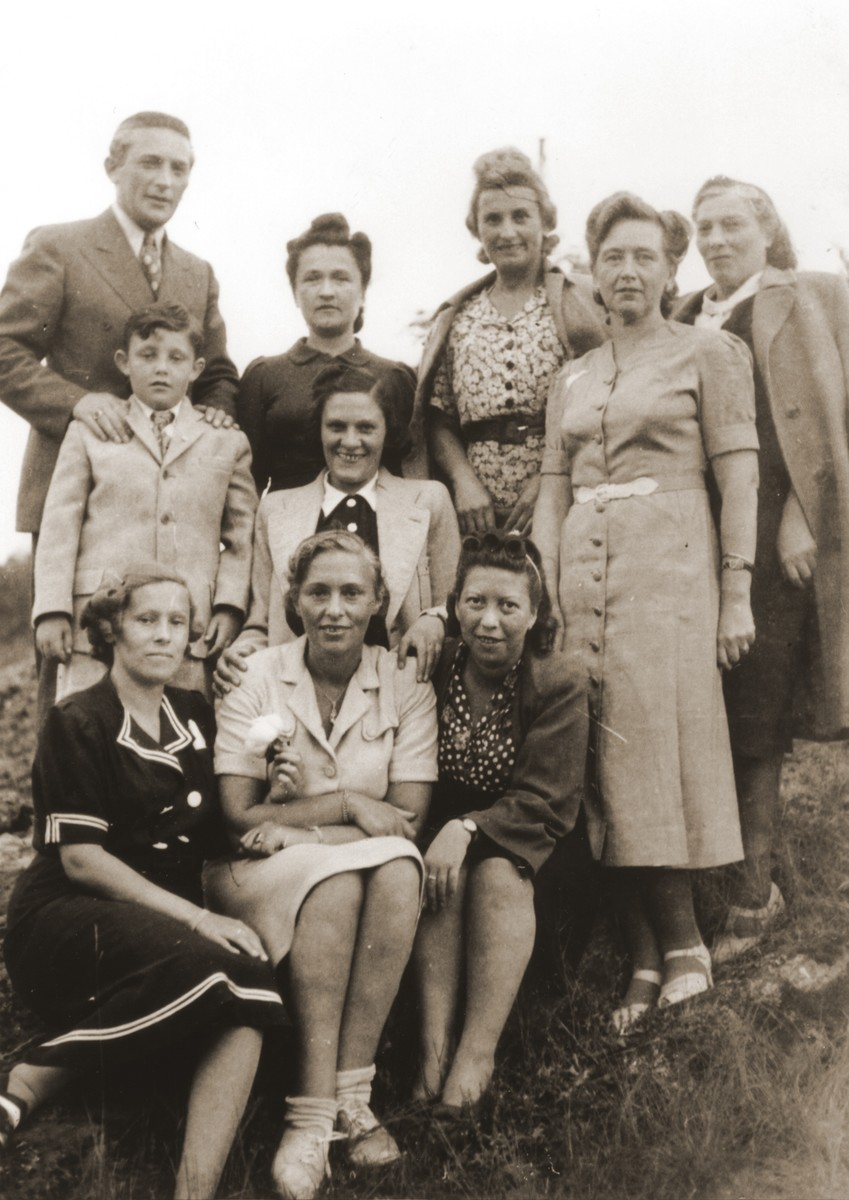 Felicja Berland poses with a group of Jewish DPs living in Sweden.