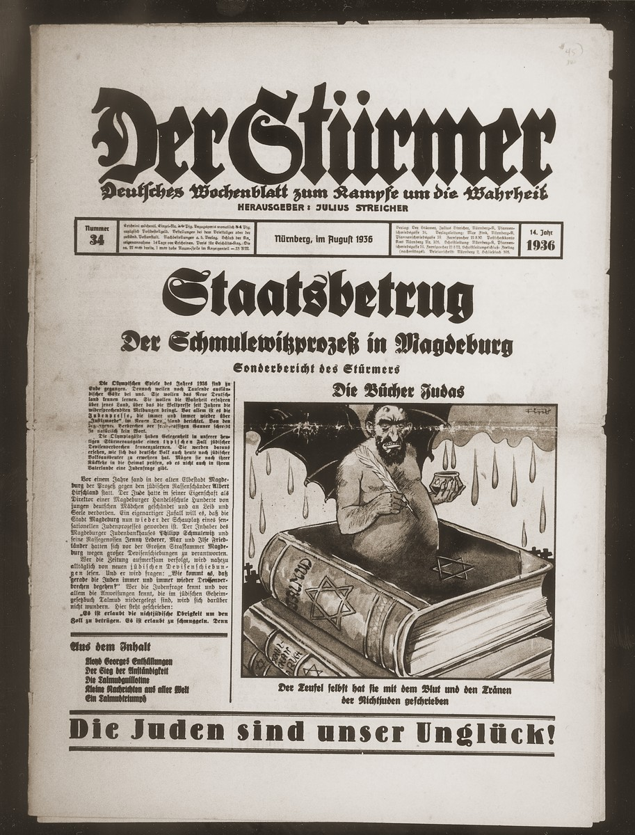 "Front page of the Nazi publication, Der Stuermer, with an anti-Semitic caricature depicting the Jew as a traitor.  The caption reads, ""The book of Judas/The Devil himself wrote the Talmud with the blood and the tears of non-Jews.""  The headline reads reads, ""Treason/The Schmulewitz Trial in Magdeburg/Special issue of the Stuermer."""