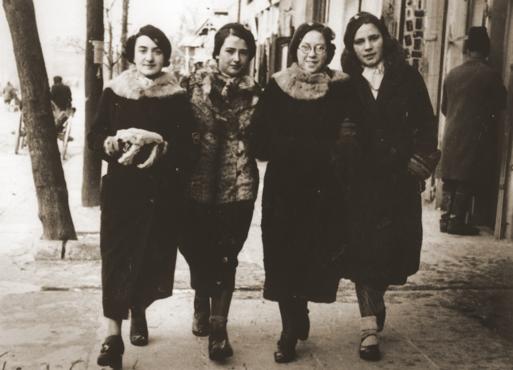 Four Jewish classmates walk along Lubelska Street in Chelm.  Pictured from left to right are: Fredka ?; Marysia Wilenko; Felicja Berland; and Hanke Aljos.