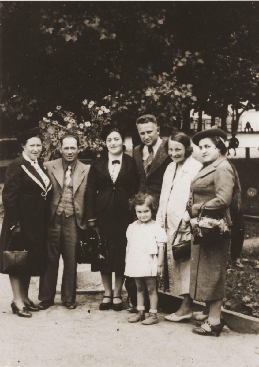Sara and Abraham Berland (left) pose with friends in a park in Chelm.