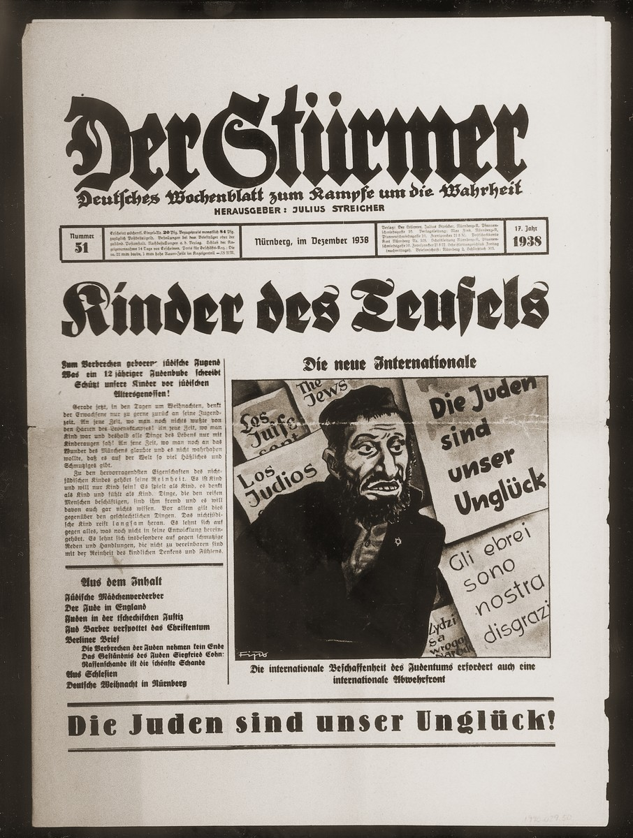 """Front page of the Nazi publication, Der Stuermer, with an anti-Semitic caricature depicting world Jewry as a """"new International.""""  The  caption under the caricature reads, """"The international composition of Jewry demands an international defense front.""""  The headline reads, """"Children of the Devil/The new international.  The sub-heading of the lead article reads, """"Jewish youth, born to criminality/What a 12 year-old Jewish rogue writes/Protect our children from their Jewish contemporaries."""""""