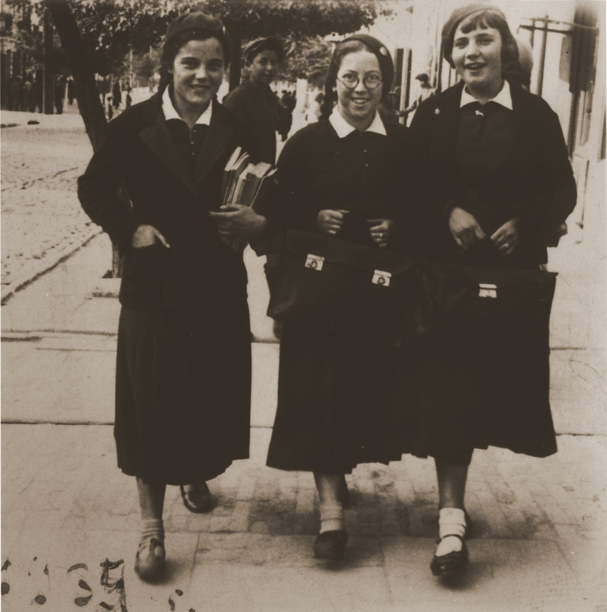 Felicja Bernard and two classmates walk home from school dressed in their school uniforms.