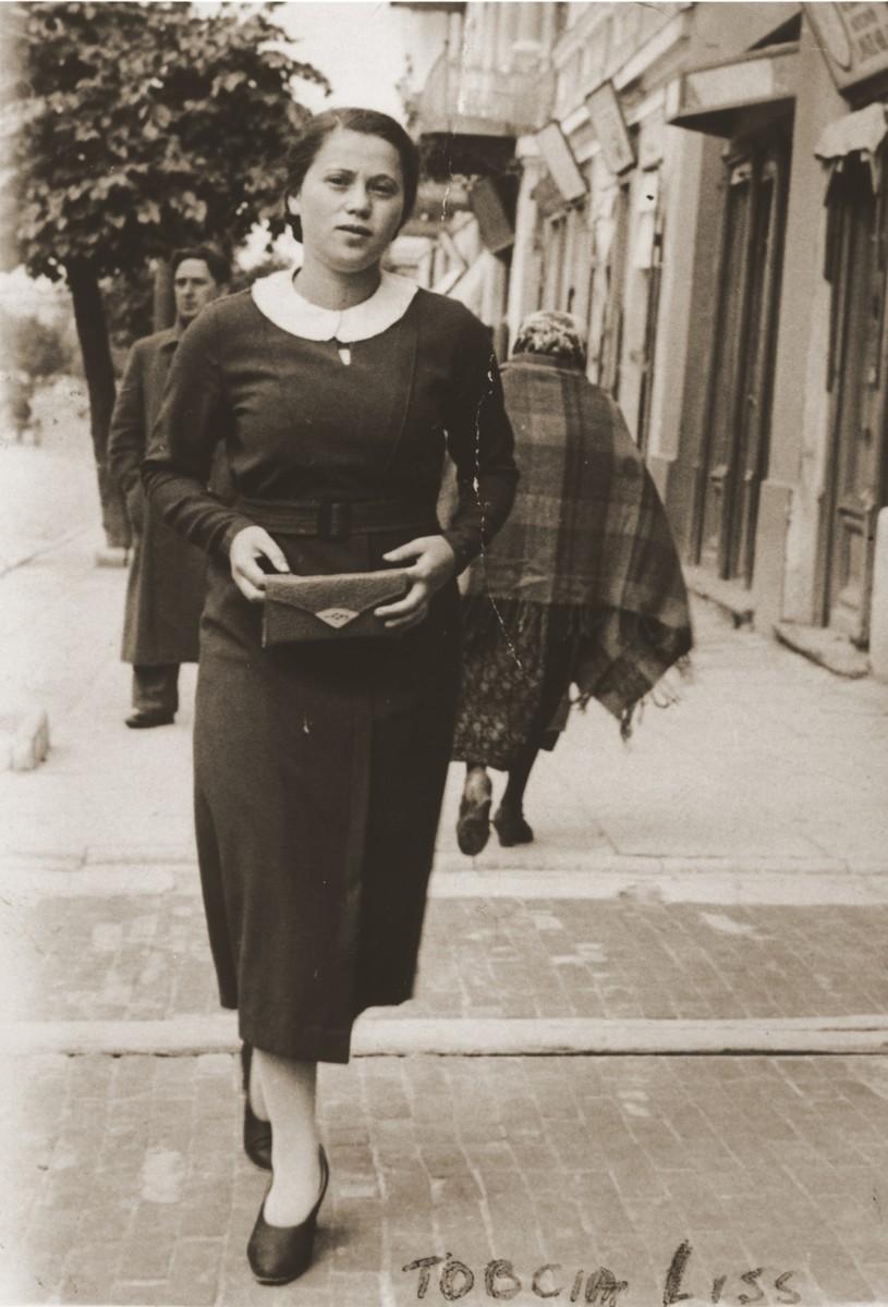 Tobcia Liss, a cousin of Felicja Berland, walks along Lubelska Street in Chelm.