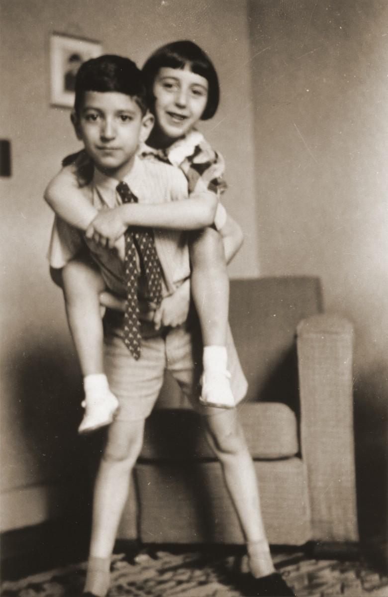 Joseph Schadur gives his sister, Benita, a piggy-back ride.