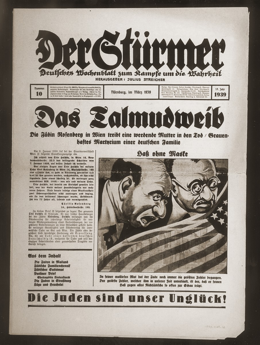 "Front page of the Nazi publication, Der Stuermer, with an anti-Semitic caricature depicting the Jew as the hater of all non-Jews.  The caption reads, ""Unmasked Hatred/ In his unbounded rage the Jew has once again committed a grave error which in our time has undercut him, [and that error is] that he so often displays his hatred against all non-Jews.""  The headline reads, ""The Talmud Wife/The Jewess Rosenberg in Vienna drives a pregnant woman to her death/Horrifying martyrdom of a German family."""
