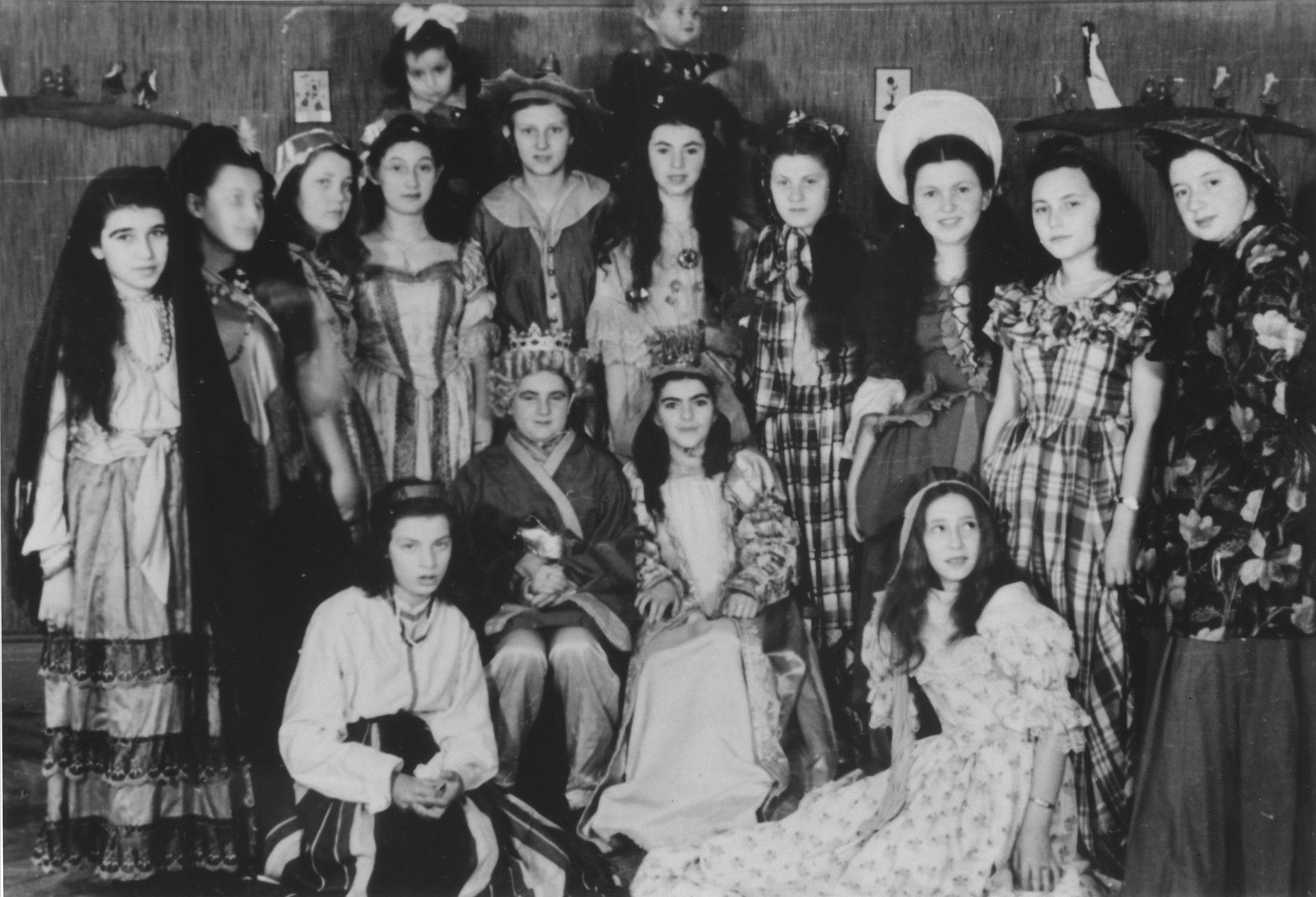 Group portrait of Jewish youth dressed in Purim costume at the Ulm displaced persons camp.  Among those pictured are Yanka Galler, Ruzia Rozen, Lila Rajs and Lila Rozen.