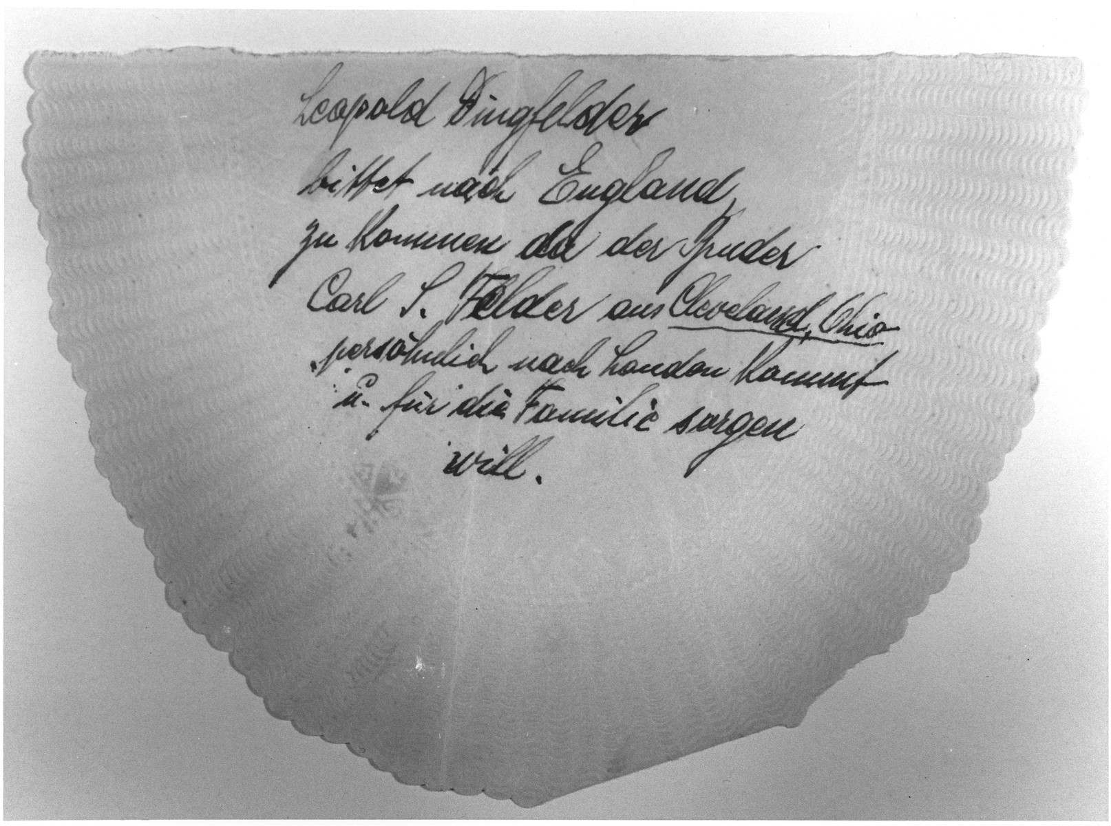 Note scribbled on a napkin by MS St. Louis passenger Leopold Dingfelder requesting that his family be given permission to disembark in London because his brother Carl Felder had traveled there from Cleveland, Ohio to help him.