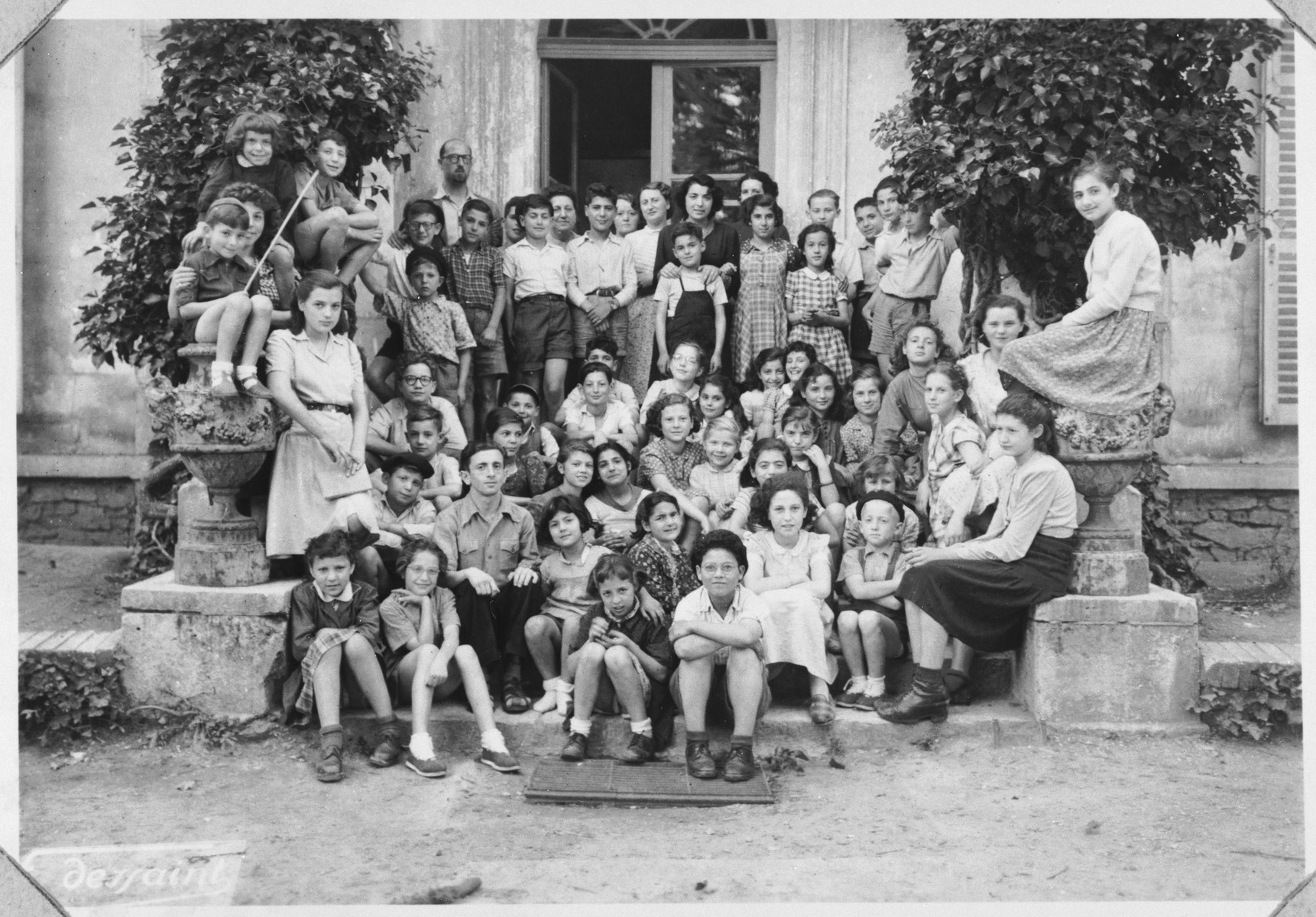Group portrait of the children and staff of the Château de Vaucelle children's home in Taverny.
