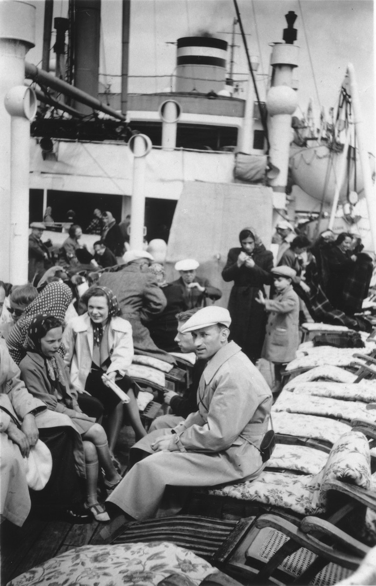 Passengers crowd the deck of the MS St. Louis.  Among those pictured are Georg Lenneberg, Fritz Hilb, Ruth and Ilse Karliner.