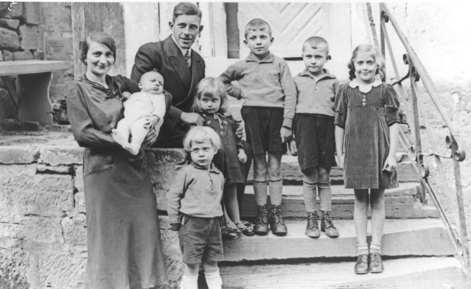 Portrait of the Wertheim family.  Pictured are Julius and Hanna (Kaiser) Wertheim (the uncle and aunt of Sonja Kaiser) with their six children, Joseph, Julius, Ruth, Solly, Heinz, Rolf and Kerry.  The oldest daughter, Kerry, was sent on a Kindertransport to England and survived.  The rest of the family perished.