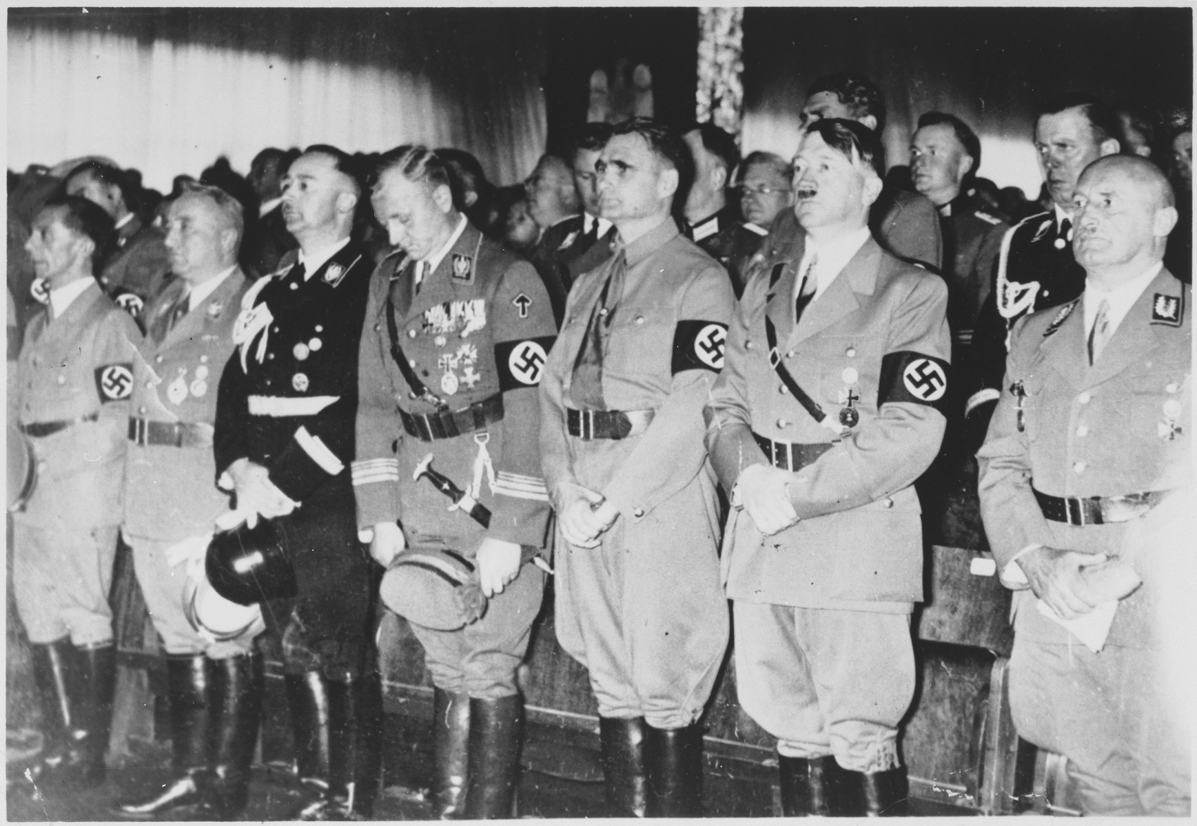 Nazi officials attend the opening ceremonies of the 1938 Party congress in Nuremberg.  Pictured from left to right are Joseph Goebbels, Robert Ley, Heinrich Himmler, Victor Lutze, Rudolf Hess, Adolf Hitler and Julius Streicher.