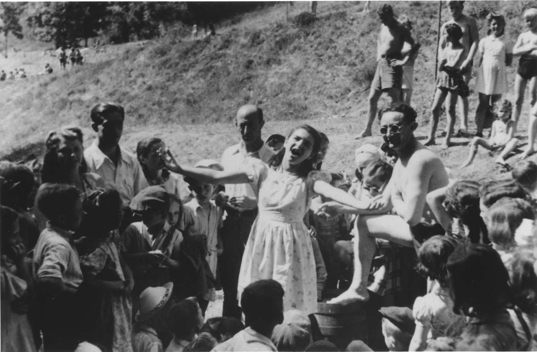 An unidentified teenage girl sings in an outdoor performance at the Ulm displaced persons camp.