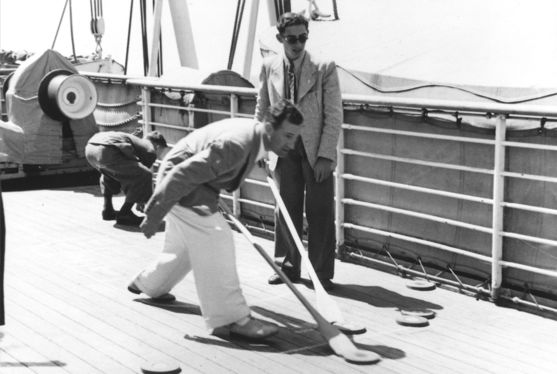 Werner Lenneberg (left) and Fritz Buff (right) play shuffleboard on the deck of the MS St. Louis.
