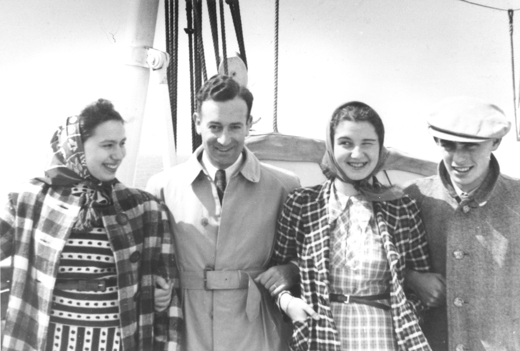 Four young Jewish refugees pose on the deck of the MS St. Louis.  Pictured from left to right are Hilde Pander, Walter Lenneberg, unknown and Fritz Buff.