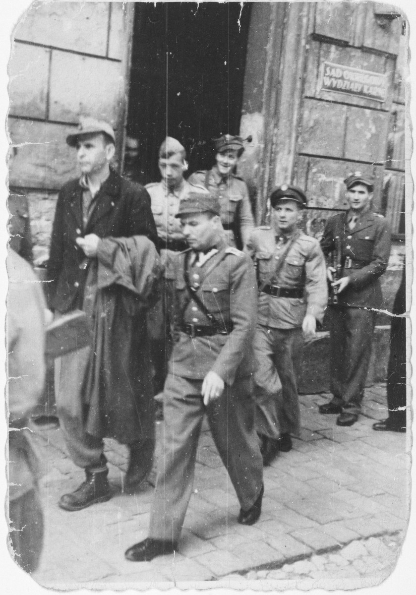 Amon Goeth, former commandant of the Plaszow concentration camp, is led away from the courthouse after being sentenced to death.
