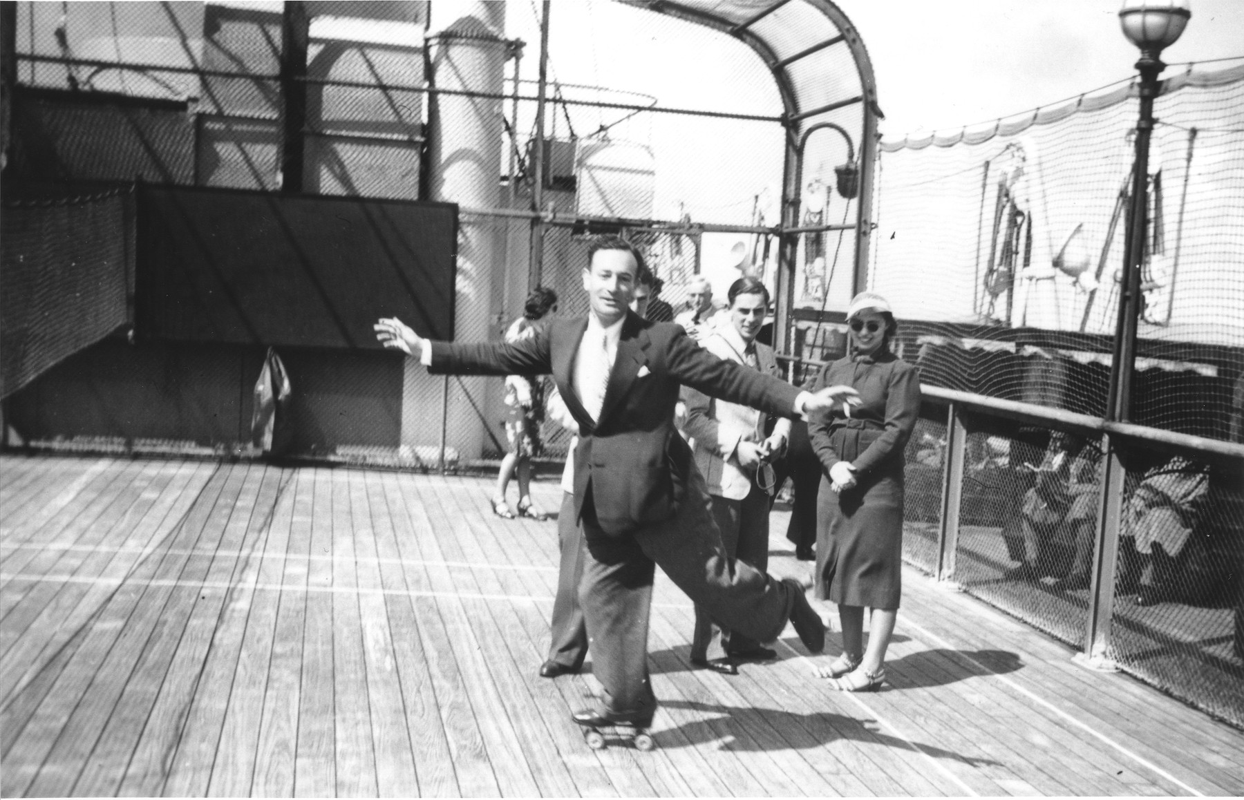 German Jewish refugee Werner Lenneberg roller skates on the deck of the MS St. Louis.