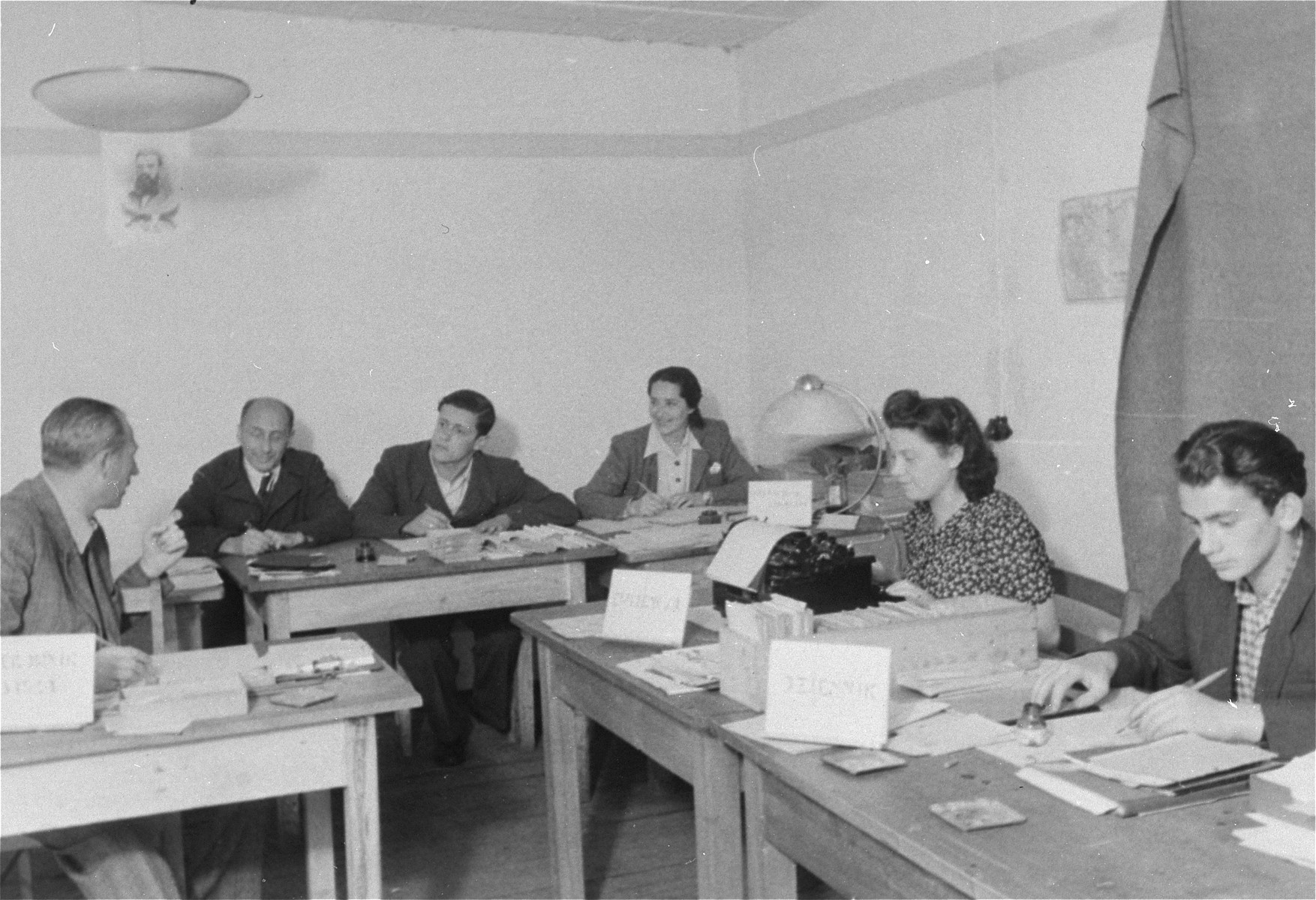 Jewish displaced persons work in the Zeilsheim camp offices.