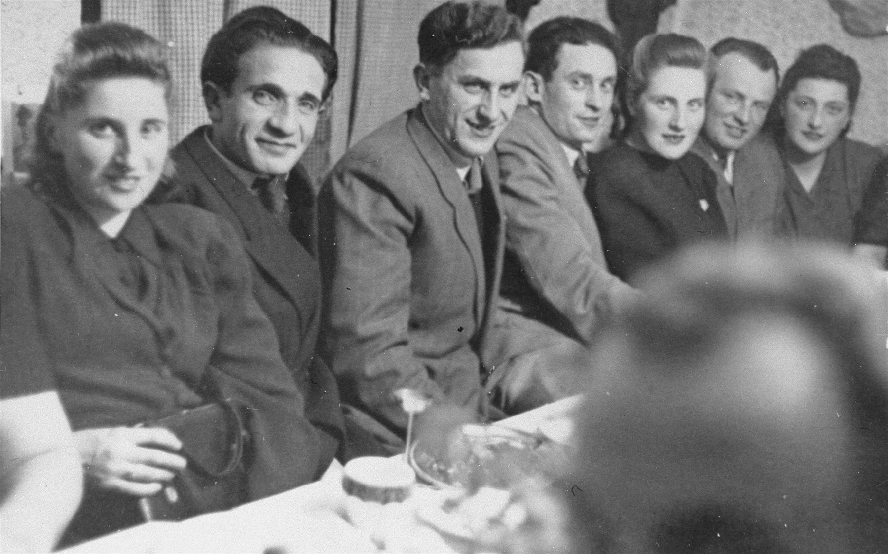 Young Jewish DPs attend a party at the Foehrenwald displaced persons camp.  Pictured (left to right) are Rose and Leon Badner, David Bajer, Israel and Ester Korman, and the Mandelbaums.
