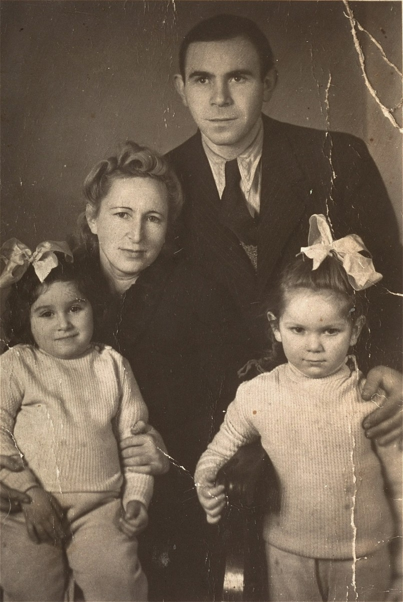 Henia Wisgardisky with her parents and cousin, Bluma Berk, in the Zeilsheim displaced persons camp.