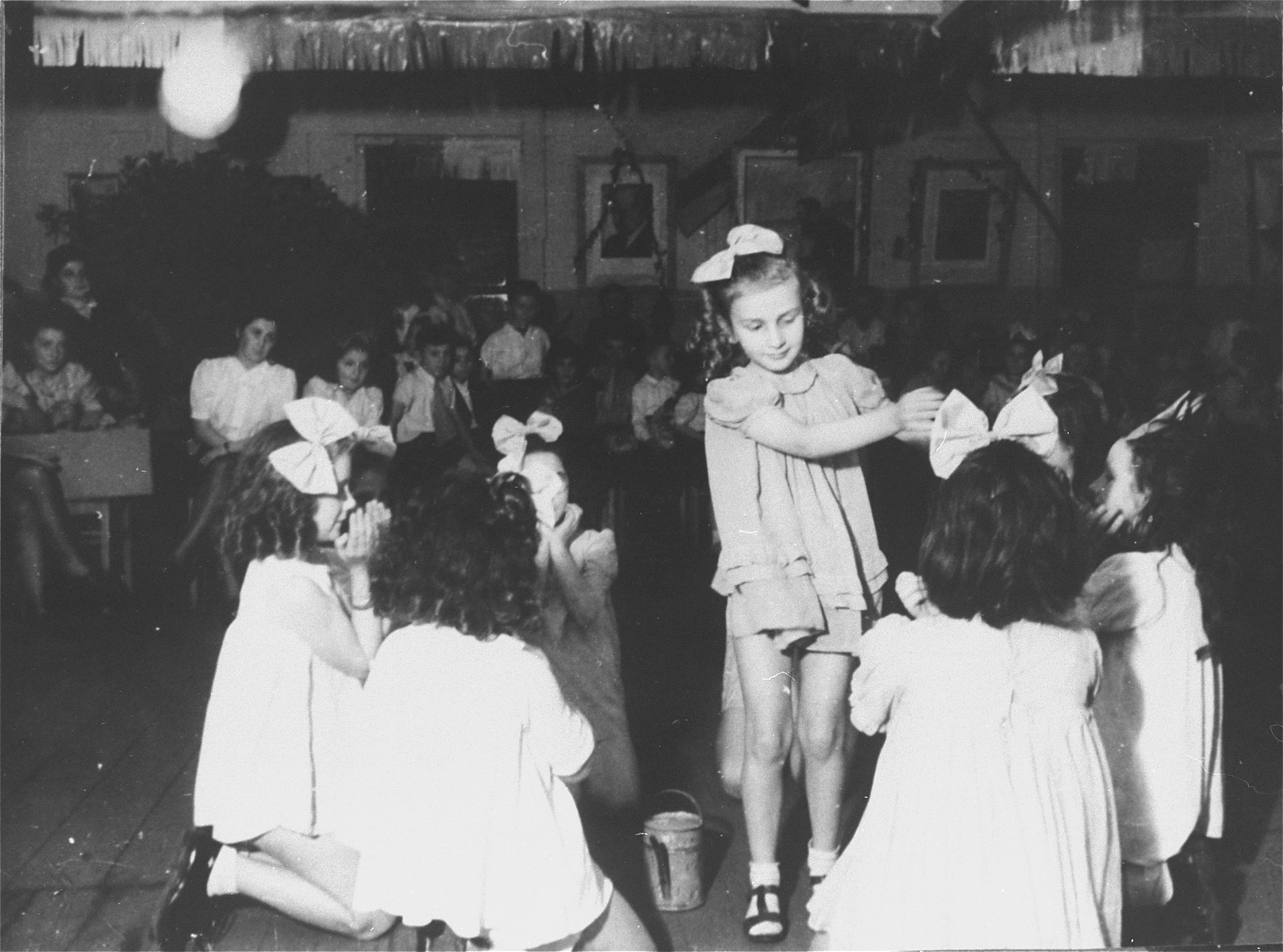 Children perform a dance during a celebration in the Zeilsheim displaced persons' camp.