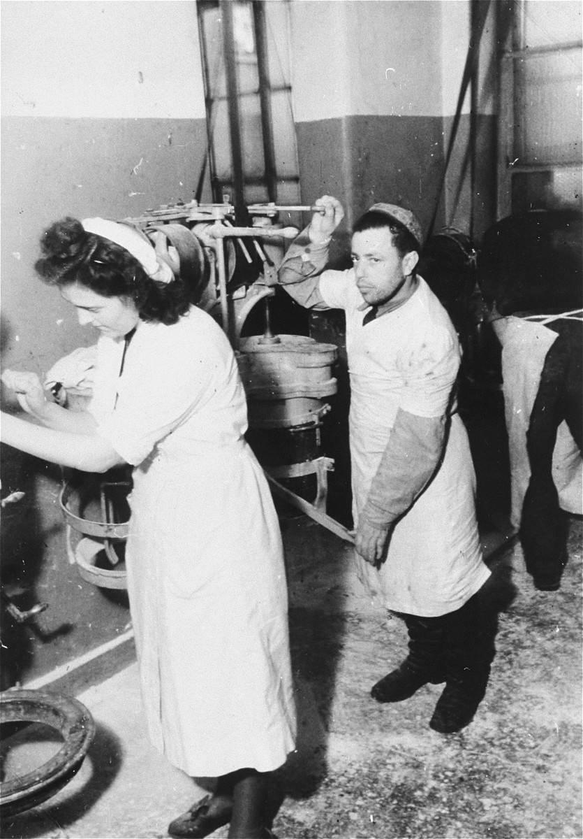 A man and a woman work in the matzah bakery in Frankfurt that escaped destruction by the Nazis.