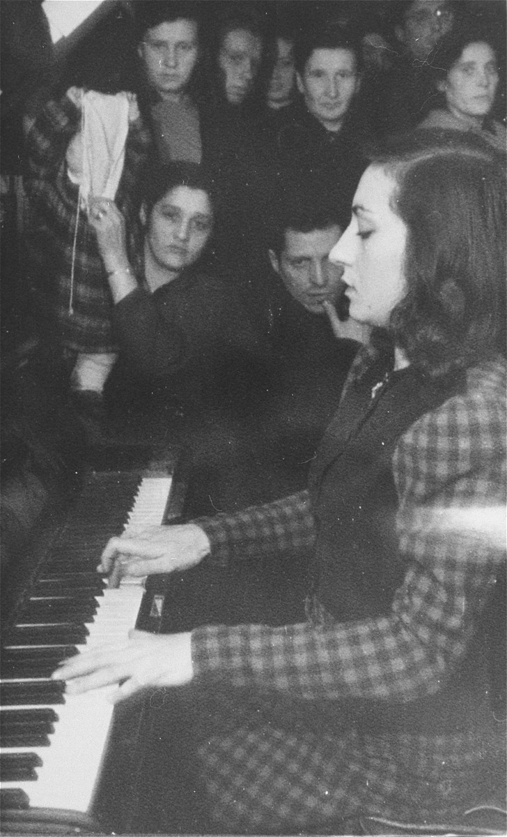 A young woman plays the piano during a Hanukkah celebration in the Zeilsheim displaced persons' camp.