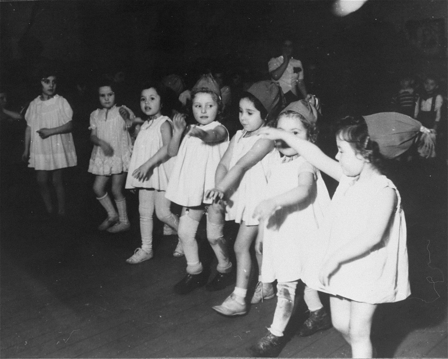 Young children perform a dance in the Zeilsheim displaced persons' camp.