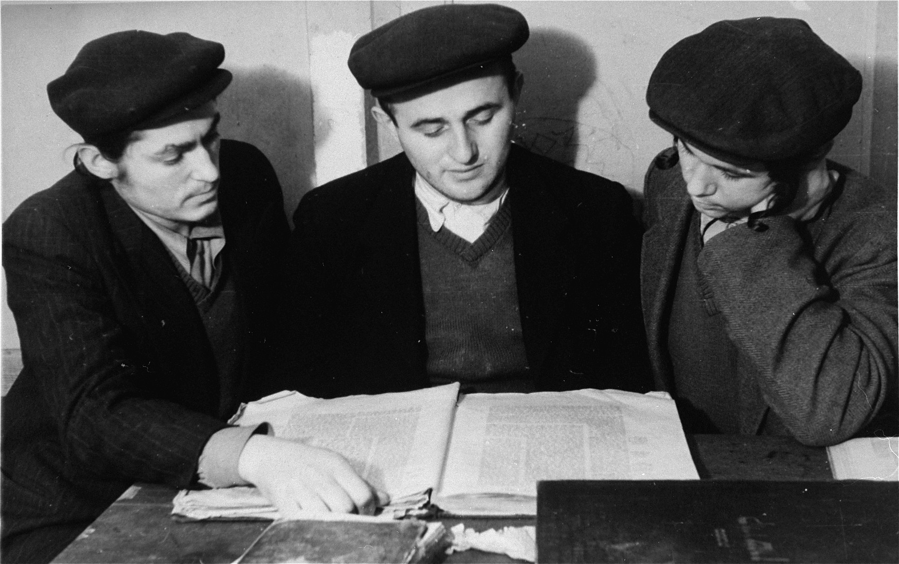 Students study Talmud at a Yeshiva in the Zeilsheim displaced persons camp.  Among those pictured (center) is Sholom Yosef Weinberger (AKA Joseph Weinberger) later of Brooklyn, NY.