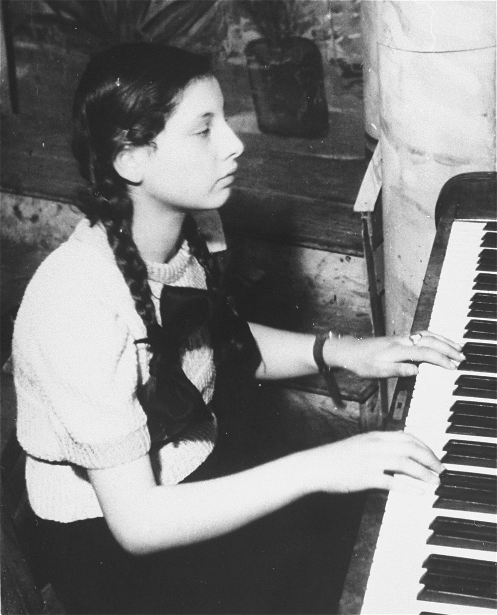 Close-up portrait of a girl playing the piano in a Purim show in the Zeilsheim displaced persons' camp.